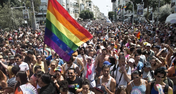 People take part at the annual Gay Pride parade in Tel Aviv June 7, 2013. Thousands of revelers on Friday paraded on the streets of Israel's free-wheeling city of Tel Aviv, which has become a Mediterranean hotspot for gay tourism. REUTERS/Nir Elias (ISRAEL - Tags: SOCIETY)